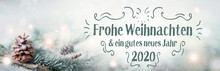 Fotomurales - Christmas greetings  2019  2020  -  German language  -  Merry Christmas and Happy New Year  -  Fir branch in sn ow landscape with magic lights