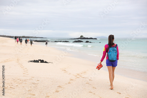 Fotomurales - Galapagos Islands - woman on cruise ship tour visiting Playa las Bachas Beach on Santa Cruz Island. Woman walking barefoot in sand enjoying pristine n