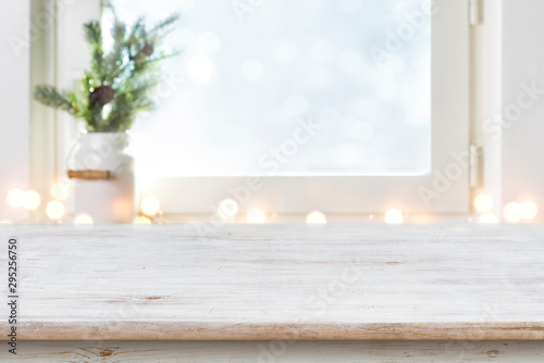 Fotomurales - Blurred winter holiday background with vintage wooden table in front