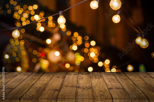Fotomurales - Image of wooden table in front of abstract blurred restaurant lights background