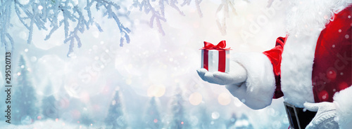 Fotomurales - Christmas present from Santa Claus. Winter Holiday Background